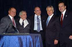 Honoree Muhtar Kent (center) flanked by (L-R) USCIB Chairman William G. Parrett, Harvard's Hal Scott, Senator Chuck Hagel and USCIB President Peter M. Robinson.