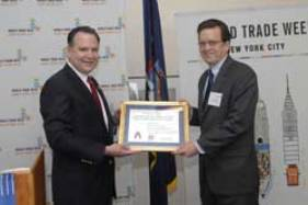 USCIB President and CEO Peter Robinson (right) accepts the Commerce Department's Export Appreciation Award from James Cox, Northeast network director with the U.S. Commercial Service.