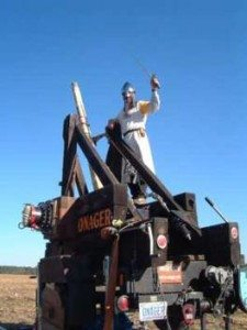"Bob Carbo atop the Onager, his pumpkin catapult, at the European ""punkin chunkin"" championships in Belgium."