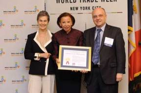 Rep. Nydia Velázquez (D. – N.Y.) congratulates award winners Kristin McDonough and Peter Bengston of the New York Public Library's Science, Industry and Business Library.