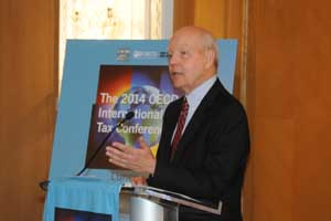 IRS Commissioner John Koskinen addressing the conference