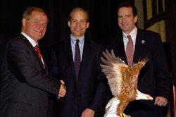Dr. Johnson with USCIB Chairman William G. Parrett (left) and USCIB President Peter M. Robinson