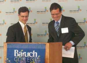 Awards breakfast keynote speaker Joseph Quinlan (left) is introduced by USCIB President Peter Robinson.